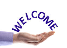 Welcome word. In male hand Royalty Free Stock Photos