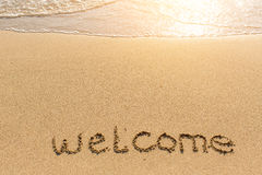 Welcome - word drawn on the sand beach Royalty Free Stock Photos