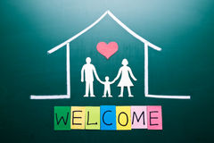 Welcome word and Family in house Stock Photos