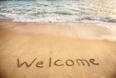 Welcome word on the sand. Beach near the ocean Royalty Free Stock Photos