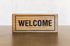 Welcome word on wooden board Stock Photography