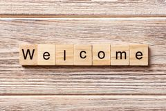 WELCOME word written on wood block. WELCOME text on table, concept stock image