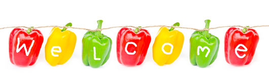 Welcome wording on bell peppers Stock Photography