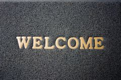 Welcome carpet. Door Mat. Background and texture. Welcome wording on gray carpet. Background and texture of Door mat. Foot Scraper Texture Background stock photo