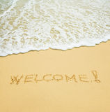 Welcome written in a sand Royalty Free Stock Photos