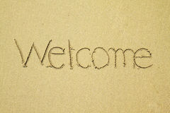 Welcome written on sand at the beach Stock Photos