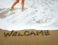Welcome. Written in the sand on the beach Stock Photos