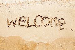 Welcome written in a sandy beach Royalty Free Stock Photos