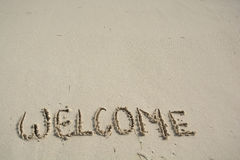 Welcome written in a tropical beach. Royalty Free Stock Image
