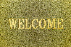 Welcome Yellow Door Mat. Welcome Carpet Background. Stock Photos