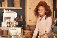 She welcomes everyone to her cafe with a smile Royalty Free Stock Image