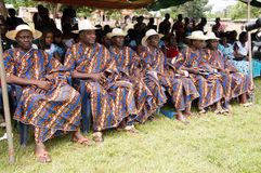 Welcomes the village authoritative. Anekro, Bongouanou, ivory coast-August 20, 2015: retired civil servants, dressed in uniform in the front row, waiting for royalty free stock image