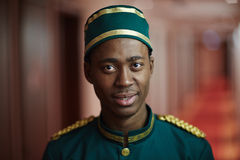 Welcoming African Bellboy in Hotel Royalty Free Stock Photo