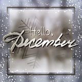 Hello December. Welcoming card with lettering. Welcoming card with white hand written lettering Hello December on natural blurry winter background with snowflake Stock Photos