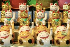 Welcoming cat oriental souvenir stock photography