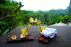 Welcoming drink. Enjoy a drink in the afternoon at one of the ubud bali's restaurants Stock Photo
