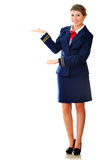 Welcoming flight attendant Royalty Free Stock Photos