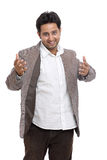 Welcoming Indian young businessman cheerfully Stock Images