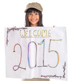 Welcoming New Year 2015 I. Young Asian preteen girl with poster of welcoming New Year 2015 Stock Images