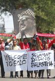 Welcoming palestine football team. Football supporter brings palestinian leader Yasser Arafat, in order to welcoming palestine football team before a friendly stock photo