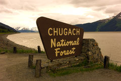A welcoming sign at the chugach national forest. The entrance to a park in alaska surrounded by nature stock photography
