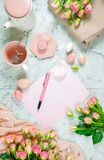 Welcoming Spring Theme Concept Tea Break With Pink Roses And Female Accessories. Stock Photo