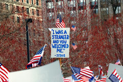 Welcoming strangers. Sign at Boston pro immigration rally: I was a stranger and you welcomed me (Matthew 25:35 Royalty Free Stock Photography