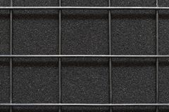 Welded wire mesh on the texture of material rough black color. Royalty Free Stock Photography