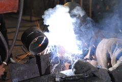 Welder. A Man is weldind a place of steel Royalty Free Stock Images