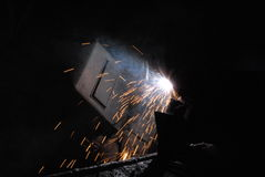 Welder. A Man is weldind a place of steel Royalty Free Stock Image