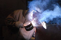 Welder. A Man is weldind a place of steel Stock Photo
