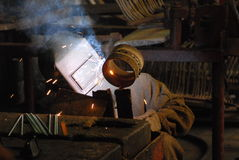 Welder. A Man is weldind a place of steel Royalty Free Stock Photos
