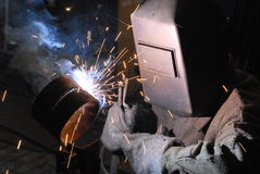 Welder. A Man is weldind a place of steel Stock Images