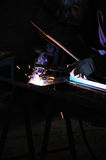 Welder. Welding worker welding steel in his workshop Royalty Free Stock Photography