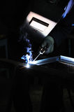 Welder. Welding worker welding steel in his workshop Royalty Free Stock Image