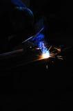 Welder. Welding worker welding steel in his workshop royalty free stock photography