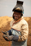 Welder. Oil and gas pipeline welder worker with safetly mask, gloves and equipment Stock Photography