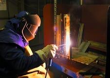Welder. Working in factory focus on worker Royalty Free Stock Image