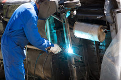 Welder. In action, repairing an old car Royalty Free Stock Photos