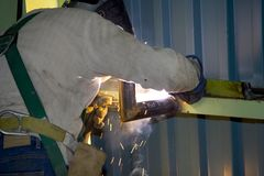 Welder 3. A worker welding pipe Royalty Free Stock Images