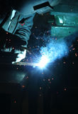 Welder. A welder welding a steel beam with blue light Stock Photos