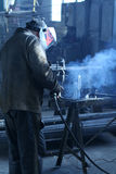 Welder. A worker is welding steel Stock Images