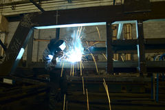 Welder. Welds design from metal Royalty Free Stock Image