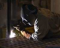 Welder. At night welding a pipe stock images