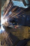 Welder in action. Close-up of industrial welder Stock Image