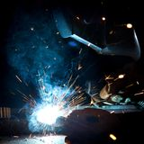 Welder in action with bright sparks. Royalty Free Stock Photography