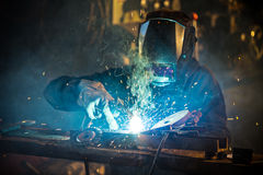 Welder in action with bright sparks. Stock Image