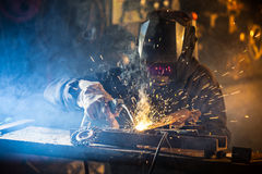 Welder in action with bright sparks. Stock Photo