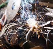 Welder in action with bright sparks. Stock Photos