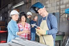 Welder apprenticeship lesson. With two trainee women stock photos